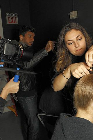 Arm, Hand, Mammal, Wrist, Video camera, Camera, Film camera, Long hair, Gesture, Thumb,
