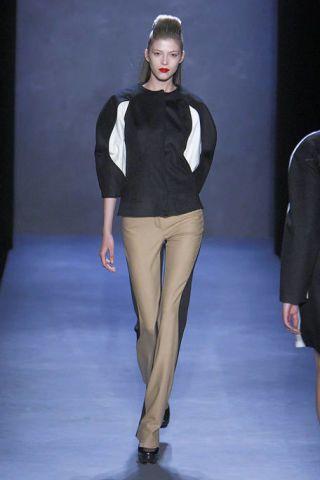 Leg, Brown, Sleeve, Human body, Shoulder, Human leg, Fashion show, Joint, Outerwear, White,