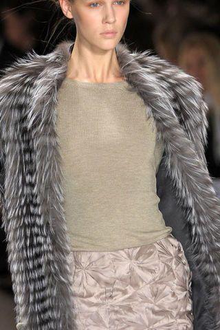 Lip, Skin, Shoulder, Fashion show, Textile, Style, Fashion model, Fur clothing, Natural material, Street fashion,