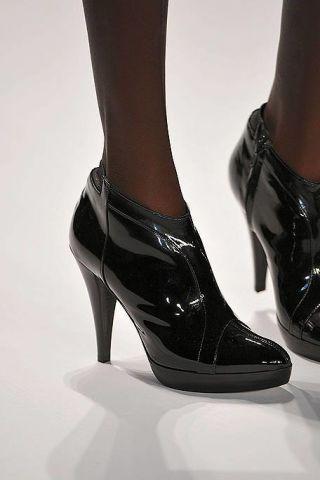 Footwear, Joint, Human leg, Fashion, Black, Leather, High heels, Sandal, Fashion design, Silver,