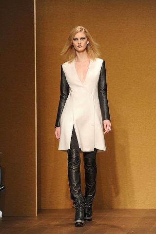 Clothing, Outerwear, Knee-high boot, Style, Fashion show, Boot, Knee, Fashion, Fashion model, Thigh,