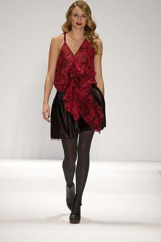 Clothing, Shoulder, Human leg, Textile, Joint, Fashion show, Waist, Dress, Fashion model, Knee,