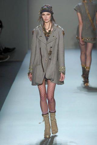 Clothing, Leg, Fashion show, Brown, Shoulder, Textile, Joint, Runway, Outerwear, Human leg,
