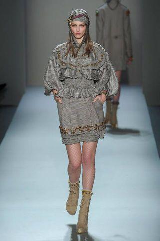 Clothing, Leg, Fashion show, Sleeve, Shoulder, Human leg, Textile, Runway, Joint, Outerwear,