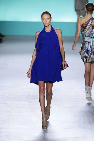 Clothing, Leg, Fashion show, Blue, Dress, Event, Human body, Human leg, Shoulder, Runway,