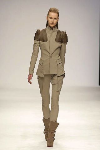 Clothing, Human, Brown, Human body, Sleeve, Shoulder, Joint, Standing, Fashion show, Khaki,