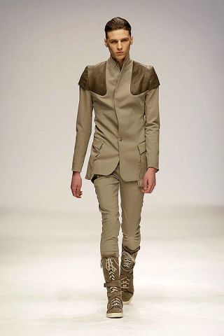 Clothing, Human, Brown, Human body, Sleeve, Shoulder, Khaki, Collar, Cap, Fashion show,