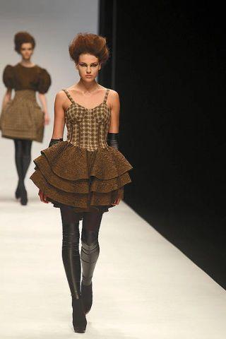 Clothing, Leg, Human, Brown, Fashion show, Human body, Shoulder, Textile, Joint, Runway,