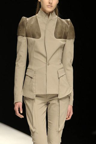 Clothing, Collar, Sleeve, Human body, Shoulder, Standing, Textile, Suit trousers, Joint, Khaki,