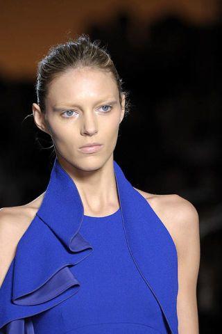 Clothing, Ear, Hairstyle, Shoulder, Eyebrow, Style, Sleeveless shirt, Electric blue, Fashion, Beauty,