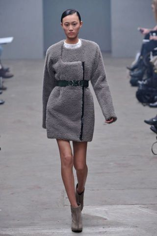 Clothing, Sleeve, Human body, Shoulder, Human leg, Fashion show, Dress, Joint, Runway, Fashion model,
