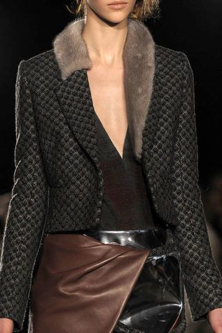 Brown, Sleeve, Shoulder, Fashion show, Textile, Collar, Joint, Outerwear, Fashion model, Style,