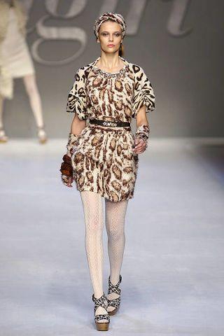 Clothing, Human, Leg, Fashion show, Dress, Shoulder, Human leg, Runway, Joint, Fashion model,