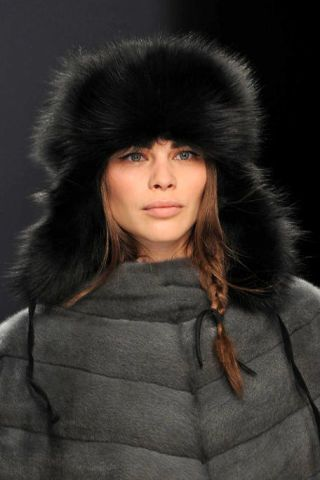 Clothing, Lip, Sleeve, Textile, Fur clothing, Headgear, Black hair, Animal product, Costume accessory, Natural material,