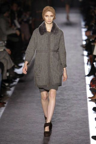 Brown, Fashion show, Sleeve, Shoulder, Runway, Joint, Outerwear, Human leg, Style, Fashion model,