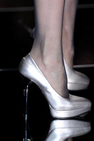 High heels, Joint, Human leg, Basic pump, Black, Sandal, Foot, Bridal shoe, Dancing shoe, Close-up,