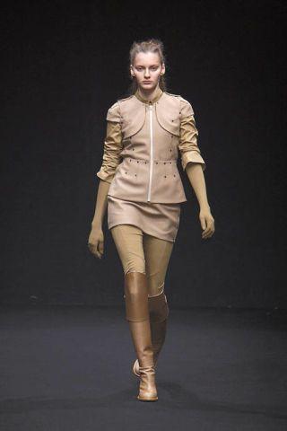 Clothing, Brown, Sleeve, Human body, Textile, Fashion show, Joint, Outerwear, Jacket, Khaki,