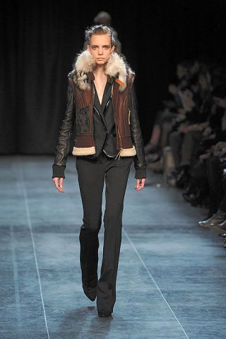 Clothing, Brown, Fashion show, Shoulder, Textile, Jacket, Runway, Joint, Outerwear, Fashion model,
