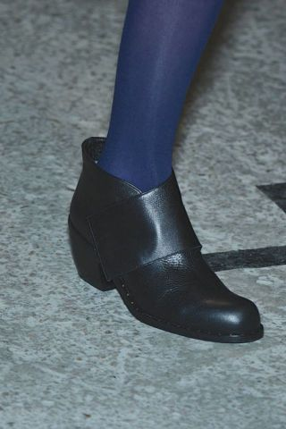 Human leg, Black, Grey, Leather, Material property, Close-up, Silver, Dress shoe, Tights, Synthetic rubber,