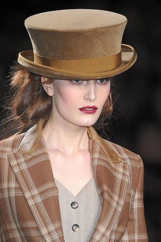 Clothing, Lip, Hat, Brown, Hairstyle, Sleeve, Collar, Chin, Textile, Coat,