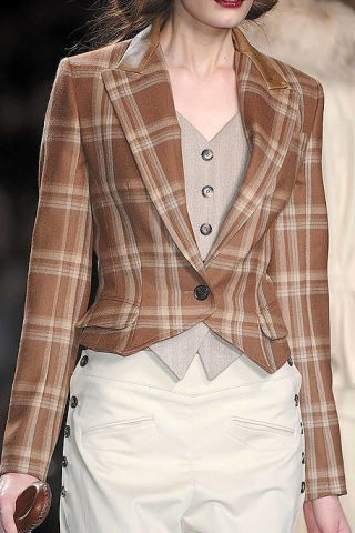 Clothing, Lip, Brown, Dress shirt, Collar, Sleeve, Shoulder, Pattern, Textile, Plaid,