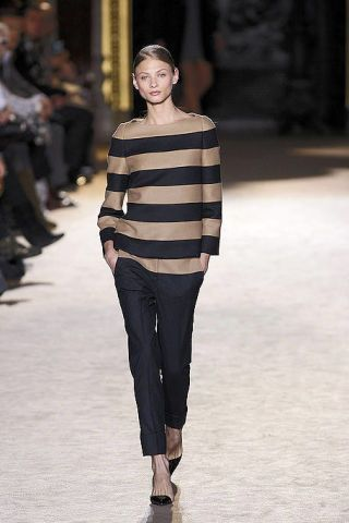 Footwear, Leg, Brown, Sleeve, Trousers, Human body, Shoulder, Fashion show, Joint, Outerwear,