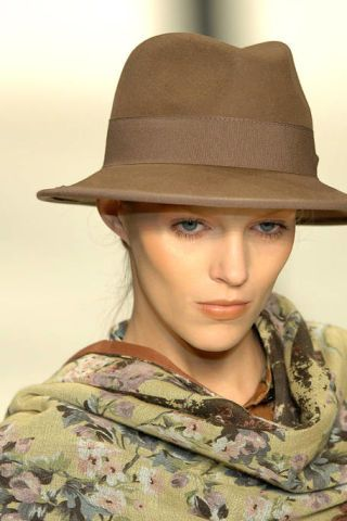 Hat, Lip, Brown, Skin, Chin, Military camouflage, Fashion accessory, Style, Khaki, Headgear,