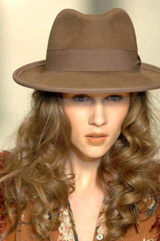 Hat, Lip, Brown, Hairstyle, Chin, Style, Fashion accessory, Headgear, Beauty, Costume accessory,