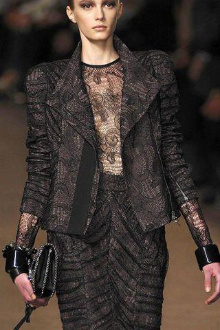 Clothing, Lip, Coat, Human body, Fashion show, Collar, Outerwear, Formal wear, Style, Fashion model,