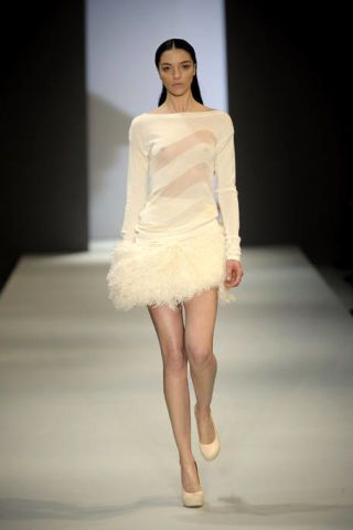 Clothing, Human, Fashion show, Hairstyle, Skin, Dress, Shoulder, Human leg, Runway, Joint,