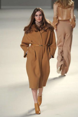 Clothing, Leg, Brown, Sleeve, Fashion show, Shoulder, Textile, Runway, Khaki, Joint,