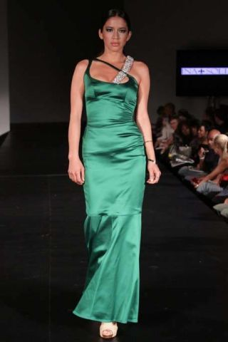 Clothing, Hairstyle, Dress, Shoulder, Joint, Fashion show, Formal wear, Fashion model, Style, One-piece garment,