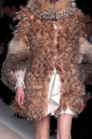 Brown, Skin, Textile, Joint, Natural material, Fashion model, Fur clothing, Fashion, Neck, Jacket,