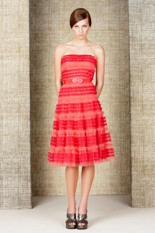 Clothing, Skin, Dress, Shoulder, Textile, Joint, Red, Human leg, One-piece garment, Pattern,