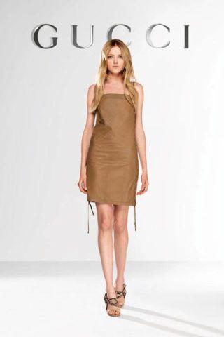Clothing, Skin, Human leg, Dress, Shoulder, Joint, One-piece garment, Style, Fashion model, Knee,