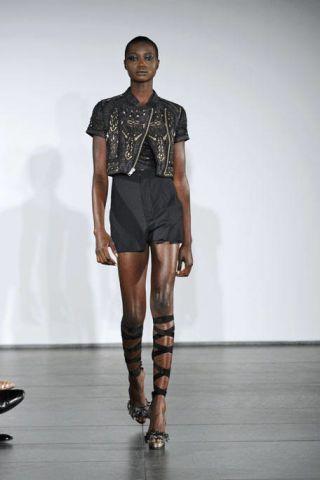 Clothing, Leg, Fashion show, Sleeve, Human body, Shoulder, Human leg, Joint, Outerwear, Runway,