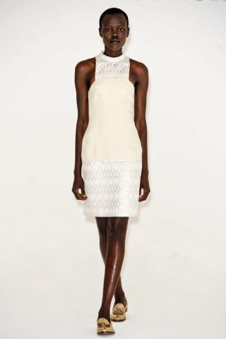 Clothing, Brown, Human body, Human leg, Shoulder, Joint, Standing, White, Style, Sleeveless shirt,