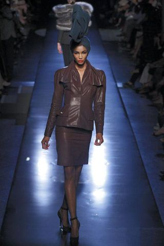 Clothing, Leg, Brown, Sleeve, Fashion show, Joint, Outerwear, Runway, Standing, Jacket,