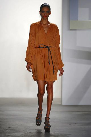 Clothing, Brown, Shoulder, Human leg, Fashion show, Joint, Style, Runway, Fashion model, Dress,