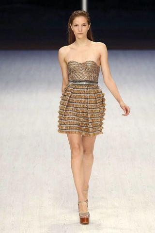 Clothing, Leg, Brown, Human leg, Skin, Dress, Human body, Shoulder, Fashion show, Joint,
