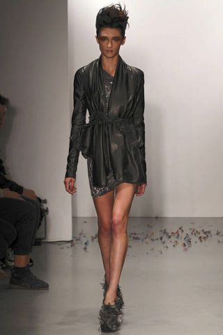 Footwear, Leg, Sleeve, Shoulder, Human leg, Textile, Fashion show, Joint, Outerwear, Style,