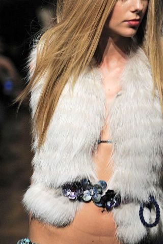 Lip, Fashion model, Fur clothing, Street fashion, Natural material, Fashion, Long hair, Fur, Blond, Model,