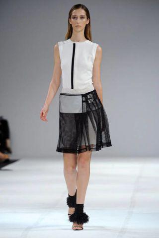 Clothing, Sleeve, Fashion show, Shoulder, Human leg, Joint, White, Waist, Fashion model, Style,