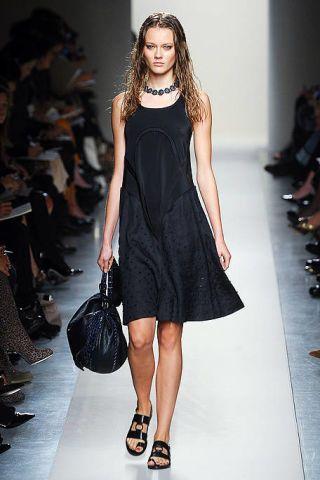 Clothing, Dress, Shoulder, Shoe, Human leg, Joint, Formal wear, Style, Fashion show, One-piece garment,
