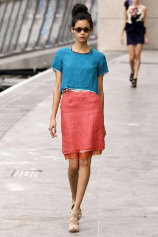 Clothing, Footwear, Leg, Brown, Human leg, Sleeve, Human body, Shoulder, Textile, Standing,
