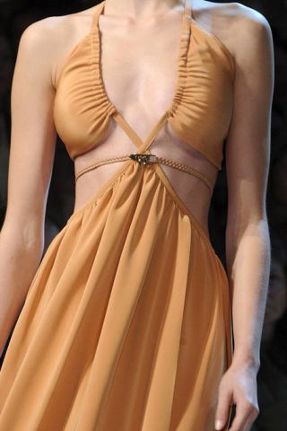 Clothing, Brown, Yellow, Shoulder, Dress, Joint, Formal wear, One-piece garment, Amber, Orange,