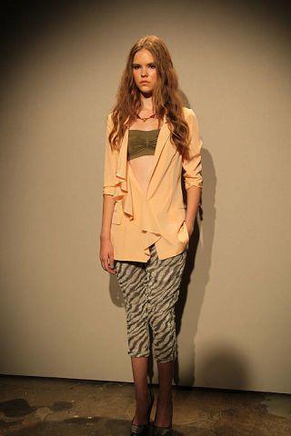 Clothing, Sleeve, Shoulder, Human leg, Joint, Style, Khaki, Knee, Floor, Flooring,