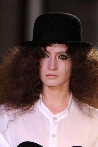 Lip, Hat, Hairstyle, Collar, Sleeve, Chin, Eyebrow, Style, Headgear, Costume accessory,