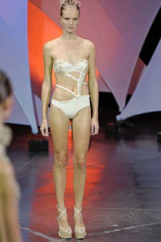 Fashion show, Shoulder, Human leg, Joint, Runway, Style, Fashion model, Waist, Thigh, Fashion,