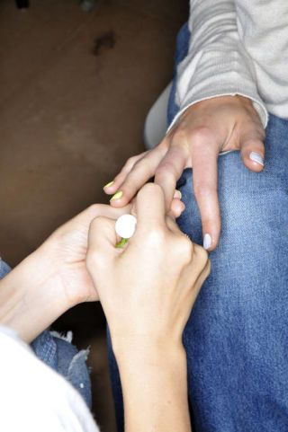 Finger, Skin, Denim, Hand, Joint, Nail, Wrist, Jewellery, Water bottle, Thumb,